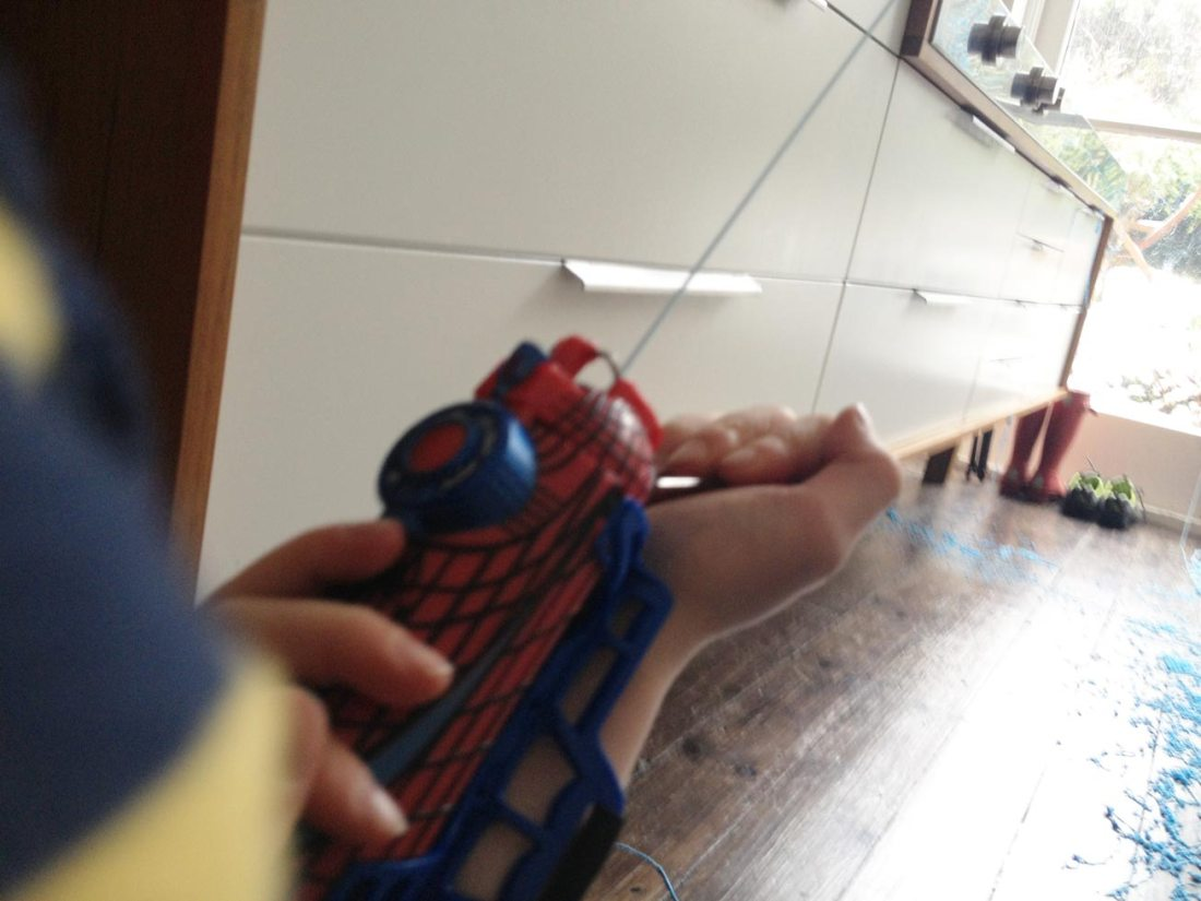 Spiderboy covers kitchen in webbing